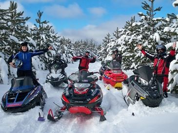 photo of fun group snowmobiling